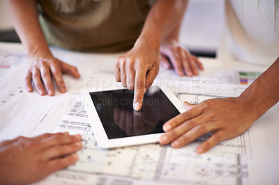 Buy stock photo Cropped shot of a group of designers using a digital tablet
