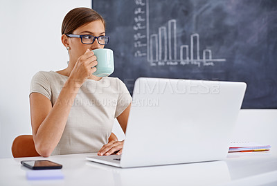 Buy stock photo Portrait of a young business woman sitting at a desk sipping coffee