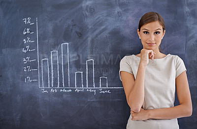 Buy stock photo Cropped shot of an attractive businesswoman beside a blackboard