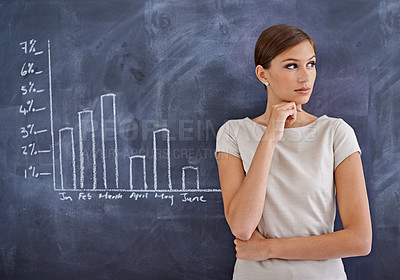 Buy stock photo Cropped shot of an attractive business woman beside a blackboard