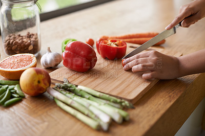 Buy stock photo Close-up cropped image of a woman preparing food on a chopping board