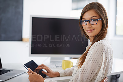 Buy stock photo Portrait of a woman with glasses sitting at her desk while using her digital tablet