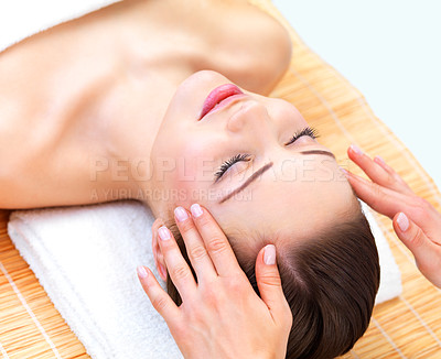 Buy stock photo Close up portrait of a young happy smiling woman receiving facial massage