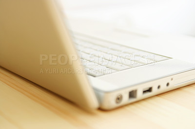 Buy stock photo Nice laptop on wooden table. Warm light shining through.
