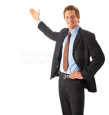 Buy stock photo A portrait of a young businessman holding his arm out presenting something. Room to add an object, or some text. Conceptual graphic image.