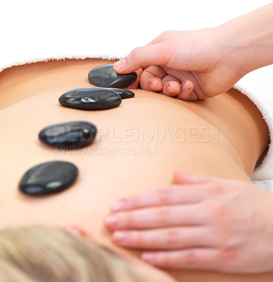 Buy stock photo Hot stones on back of a young female - Portrait of a beautiful young girl at the day spa with black stones on her bare back