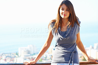 Buy stock photo Cute young girl standing on the balcony and looking away - copyspace