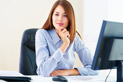 Buy stock photo Portrait of beautiful female executive sitting at an office table