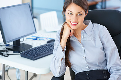 Buy stock photo Portrait of beautiful businesswoman sitting on an office chair and smiling