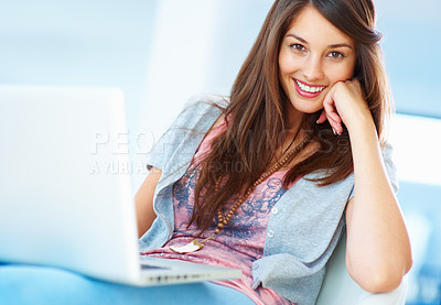 Buy stock photo Portrait of young girl sitting on chair using laptop and smiling