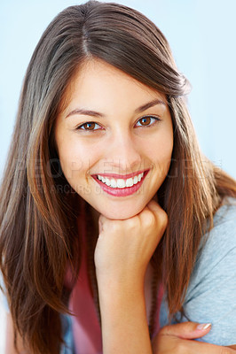 Buy stock photo Closeup of young girl with hand on chin and giving you cute smile
