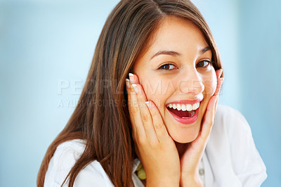Buy stock photo Closeup of surprised girl holding her face and smiling