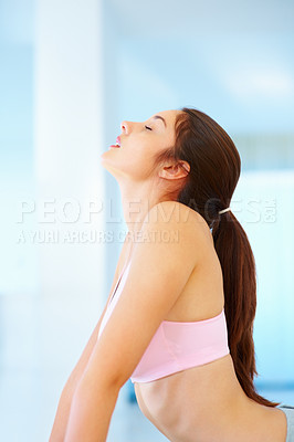 Buy stock photo Young woman doing yoga meditation during workout session