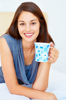 Buy stock photo Portrait of beautiful young woman holding cup of coffee and smiling