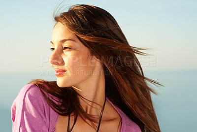 Buy stock photo Closeup of cute young female smiling and looking away