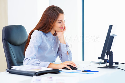 Buy stock photo Portrait of happy female executive using computer at workplace