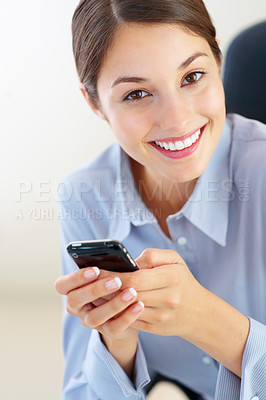 Buy stock photo Closeup of smiling executive sitting on chair and using cellphone