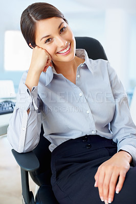 Buy stock photo Portrait of cute female executive sitting on chair and smiling