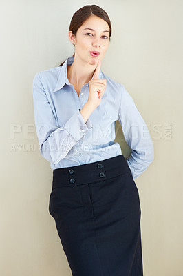Buy stock photo Portrait of business woman making gun shape with her hand and blowing off imaginative smoke
