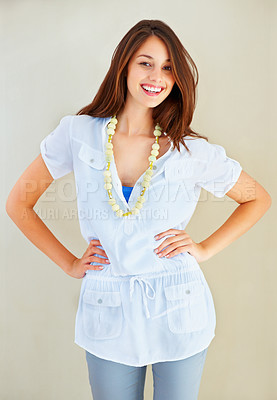 Buy stock photo Portrait of smiling young woman with hands on hips