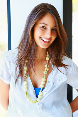 Buy stock photo Portrait of attractive young woman wearing beads and smiling