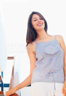 Buy stock photo Low angle view of pretty young woman smiling