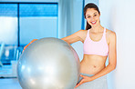 Woman standing with pilates ball