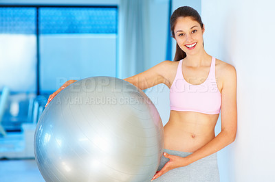 Buy stock photo Portrait of fitness young woman holding pilates ball and smiling