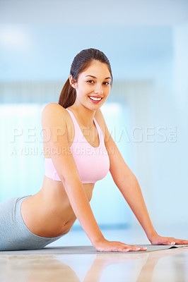 Buy stock photo Happy young woman doing stretching exercise at gym