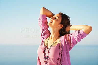 Buy stock photo Portrait of a young woman feeling free against blue sky - copyspace