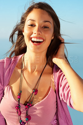 Buy stock photo Cheerful young woman enjoying freedom and wind