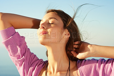 Buy stock photo Relaxed young woman with eyes closed enjoying the breeze