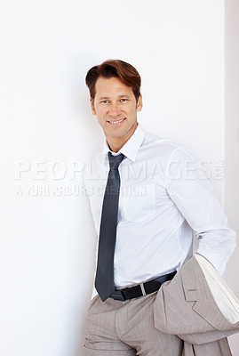 Buy stock photo Portrait of confident young businessman leaning against a white wall  - Copyspace
