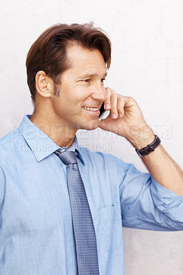 Buy stock photo Portrait of a young male business executive talking on mobile phone