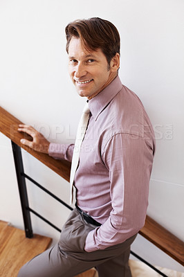 Buy stock photo Portrait of a happy young male business executive on staircase