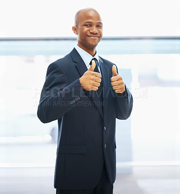 Buy stock photo Portrait of attractive businessman holding thumbs up and smiling