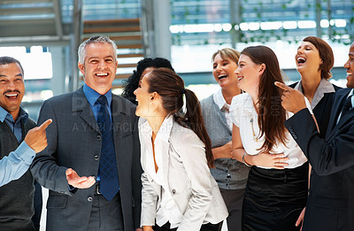 Buy stock photo Group of multi ethnic executives laughing and pointing