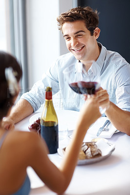 Buy stock photo Portrait of happy young man toasting with a woman in a cafe