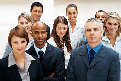 Buy stock photo Focus on young executive, surrounded by colleagues