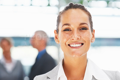 Buy stock photo Closeup of smiling businesswoman with colleagues in background
