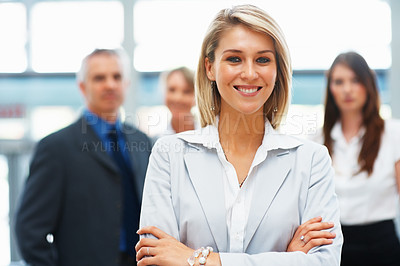 Buy stock photo Portrait of pretty businessman smiling with colleagues in background