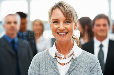 Buy stock photo Pretty businesswoman with colleagues in background