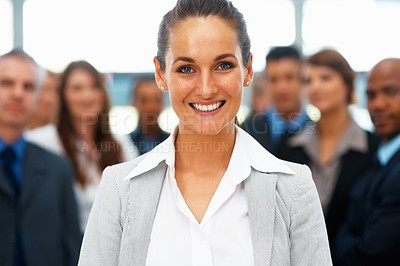 Buy stock photo Businesswoman with colleagues in distance