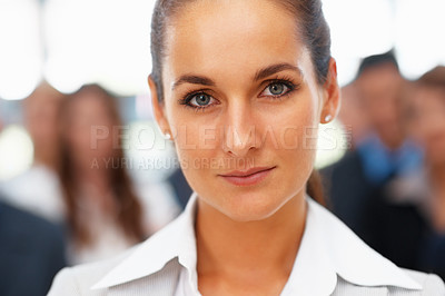Buy stock photo Closeup of female executive with colleagues in background