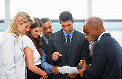 Buy stock photo Business people having a discussion indoors