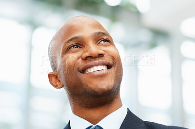 Buy stock photo Closeup of happy executive looking into distance