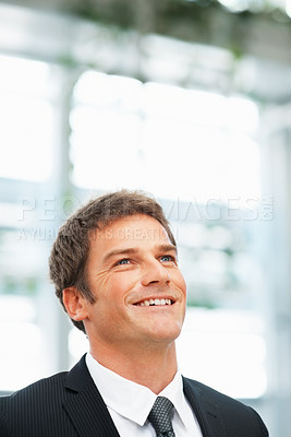 Buy stock photo Businessman looking into distance and smiling