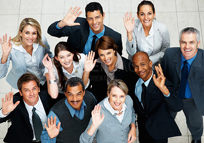 Buy stock photo Top view of executives smiling and waving