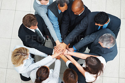 Buy stock photo Top view of business people placing their hands on top of one another