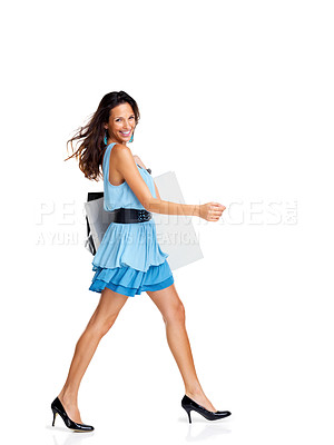 Buy stock photo Trendy young woman with a shopping bags walking on white background - Copyspace